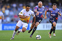 MELBOURNE, AUSTRALIA - JANUARY 26, 2010: Kevin Muscat from Melbourne Victory chases Paul Ifill from Wellington Phoenix in round 19 of the A-league match between Melbourne Victory and Wellington Phoenix FC at Etihad Stadium on January 26, 2010 in Melbourne, Australia. Photo Sydney Low www.syd-low.com