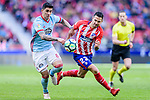 Victor Machin, Vitolo, of Atletico de Madrid (R) fights for the ball with Lucas Ariel Boye of RC Celta de Vigo (L) during the La Liga 2017-18 match between Atletico de Madrid and RC Celta de Vigo at Wanda Metropolitano on March 11 2018 in Madrid, Spain. Photo by Diego Souto / Power Sport Images