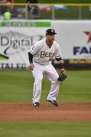 Taylor Lindsey (8) of the Salt Lake Bees on defense against the Reno Aces at Smith's Ballpark on May 5, 2014 in Salt Lake City, Utah.  (Stephen Smith/Four Seam Images)