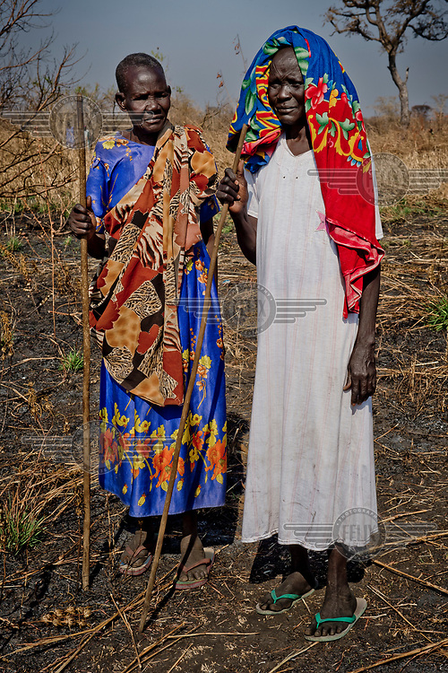 Two elderly South Sudanese refugee women, Ayak Mabior Deng, 80, (L) and Akwan Kon Mayen, who doesn't know her age, at the Nyumanzi resettlement area.