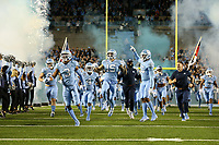 CHAPEL HILL, NC - NOVEMBER 02: Dominique Ross #3, DeAndre Hollins #15, and Beau Corrales #15 of the University of North Carolina lead their teammates onto the field during a game between University of Virginia and University of North Carolina at Kenan Memorial Stadium on November 02, 2019 in Chapel Hill, North Carolina.