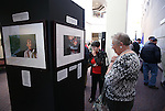 Mary Staudenmaier, of Wisconsin, center, and Sherry Siegfried, of Carson City, look at the Always Lost: A Meditation on War exhibit at the Legislative Building in Carson City, Nev., on Monday, April 6, 2015. <br />
