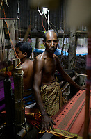 BANGLADESH, District Tangail, Kalihati, village Southpara, cottage industry, cotton Sari weaving unit, weaver working at loom / BANGLADESCH, Distrikt Tangail, Kalihati, village Southpara, Sari Weberei, Weber am Webstuhl