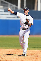 Xavier Musketeers Phil Bauer #12 during a game vs. the Akron Zips at Chain of Lakes Park in Winter Haven, Florida;  March 11, 2011.  Xavier defeated Akron 7-0.  Photo By Mike Janes/Four Seam Images