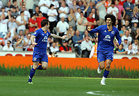 FAO SPORTS PICTURE DESK<br /> Pictured: Leighton Baines of Everton (L) with Marouane Fellaini celebrating his first goal. Saturday, 24 March 2012<br /> Re: Premier League football, Swansea City FC v Everton at the Liberty Stadium, south Wales.