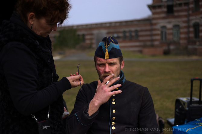 Makeup is applied to Tibo Vandenboure who plays the role of a French-speaking Belgian WWI army officer who gives orders to Dutch-speaking Belgian troops during the filming of the in Vlaamse Velden TV show in Zuydcoote, France on April 10, 2013.