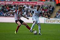 Saturday 19 October 2013 Pictured: Sebastian Larsson tackles Chico Flores of Swansea <br /> Re: Barclays Premier League Swansea City vSunderland at the Liberty Stadium, Swansea, Wales