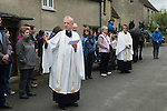 May Day Celebrations. Children from the Church of England St Mary the Virgin Primary School with their May Queen and King process to the village church to have their May garlands blessed and put on display on the church Rood Screen. 2014. Blessing of the garlands by the Revd Andrew Rycraft and The Revd Canon Charles Masheder. (background)