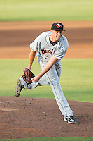Delmarva Shorebirds starting pitcher Mitch Horacek (27) follows through on his delivery against the Kannapolis Intimidators at CMC-NorthEast Stadium on July 1, 2014 in Kannapolis, North Carolina.  The Intimidators defeated the Shorebirds 5-2. (Brian Westerholt/Four Seam Images)