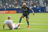 CARSON, CA - APRIL 25: Julian Araujo #2 of the Los Angeles Galaxy and Andrew Gutman #5 of New York Red Bulls battle for a ball during a game between New York Red Bulls and Los Angeles Galaxy at Dignity Health Sports Park on April 25, 2021 in Carson, California.