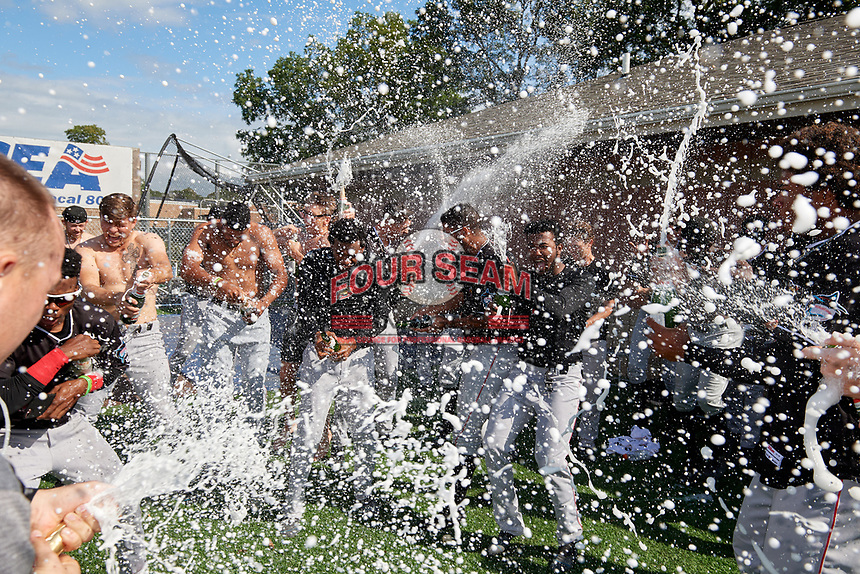 Batavia Muckdogs players, including Jonaiker Villalobos and Edison Suriel (center), celebrate after clinching the Pinckney Division Title during a NY-Penn League game against the Auburn Doubledays on September 2, 2019 at Falcon Park in Auburn, New York.  Batavia defeated Auburn 7-0 to clinch the Pinckney Division Title.  (Mike Janes/Four Seam Images)