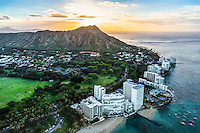 "A beautiful sunrise over Diamond Head and Kapi'olani Park along the ""gold coast"" of O'ahu."