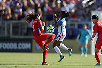 Cary, NC - Sunday October 22, 2017: Cho Sohyun and Crystal Dunn during an International friendly match between the Women's National teams of the United States (USA) and South Korea (KOR) at Sahlen's Stadium at WakeMed Soccer Park. The U.S. won the game 6-0.