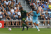 ST PAUL, MN - JULY 24: Chase Gasper #77 of Minnesota United FC and Dairon Asprilla #27 of the Portland Timbers battle for the ball during a game between Portland Timbers and Minnesota United FC at Allianz Field on July 24, 2021 in St Paul, Minnesota.