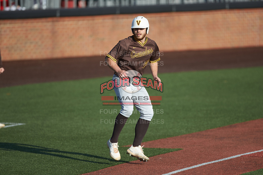 Kyle Schmack (27) of the Valparaiso Crusaders takes his lead off of third base against the Western Kentucky Hilltoppers at Nick Denes Field on March 19, 2021 in Bowling Green, Kentucky. (Brian Westerholt/Four Seam Images)