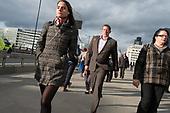 City of London workers walk across London Bridge.