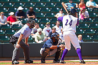 Jared Mitchell #24 of the Winston-Salem Dash stands in at the plate as catcher Jose Bonilla #9 of the Wilmington Blue Rocks and home plate umpire Mike Walsh look on at BB&T Ballpark on April 24, 2011 in Winston-Salem, North Carolina.   Photo by Brian Westerholt / Four Seam Images