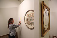 Terrilyn Wendling, assistant director of the Rogers Historical Museum, measures Friday, January 8, 2021, for the location of a one of the displays for the Valentines Insults and Flattery exhibit in the Collection Gallery of the Museum. The new Valentines Day themed exhibit will feature Valentines Day cards from 1840 to 1920. Check out nwaonline.com/210109Daily/ and nwadg.com/photos for a photo gallery.<br /> (NWA Democrat-Gazette/David Gottschalk)