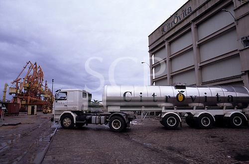 Santos Port, Sao Paulo State, Brazil. Citrovita orange juice concentrate tanker at Citrovita dockside transfer plant.