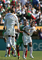 Armando Collado (4) heads the ball over Gerardo Torres (center) and Wilber Sanchez (9). Mexico defeated Nicaragua 2-0 during the First Round of the 2009 CONCACAF Gold Cup at the Oakland, Coliseum in Oakland, California on July 5, 2009.