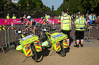 01 JUNE 2014 - LONDON, GBR - St. John Ambulance medics watch competitors as they race on the bike course around Hyde Park in London, Great Britain during the 2014 ITU World Triathlon Series Open Olympic Distance Age Group race (PHOTO COPYRIGHT © 2014 NIGEL FARROW, ALL RIGHTS RESERVED)