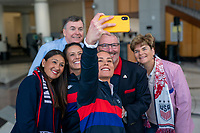 ORLANDO, FL - FEBRUARY 28: Ashlyn Harris #18 of the United States takes a selfie with Ali Krieger #11 and Orlando Mayor Buddy Dyer at City Hall on February 28, 2020 in Orlando, Florida.