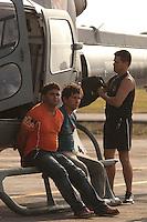 José Rodrigues Moreira, mandante do assassinato do casal de ecologistas José Cláudio e Maria do Espirito SantosRibeiro da Silva(camisata azul) e seu irmão Lindonjonson Silva Rocha(camisa laranja) um dos executores do crime chagam de helicóptero após a prisão feita a 50 km do município de Novo Repartimento no sul do Pará, onde estavam escondidos em um barraco na mata, com eles foi encontrado 3 revólveres calibre 38 espingarda, documentos e celulares.<br />  : Belém, Pará, Brasil<br />   : Foto Paulo Santos<br />    : 18/09/2011