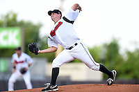Nashville Sounds pitcher Brad Mills (49) delivers a pitch during a game against the Omaha Storm Chasers on May 19, 2014 at Herschel Greer Stadium in Nashville, Tennessee.  Nashville defeated Omaha 5-4.  (Mike Janes/Four Seam Images)