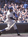 Chicago Cubs Ernie Banks (14) in action during a game  in 1962 at Wrigley Field in Chicago, Illinois .Ernie Banks played all of his 18 seasons with the Chicago Cubs and was inducted to the Baseball Hall of Fame in 1977