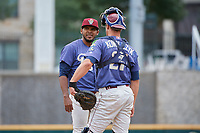 Frisco RoughRiders pitcher Esmerling Vasquez (35) talks with catcher Alex Kowalczyk (27) during a Texas League game against the Midland RockHounds on May 21, 2019 at Dr Pepper Ballpark in Frisco, Texas.  (Mike Augustin/Four Seam Images)