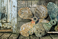 Old boat propellers on a fishing village dock, Menemsha, Martha's Vineyard, USA