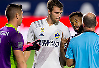 CARSON, CA - SEPTEMBER 19: David Bingham #1 GK and Nicholas DePuy #20 of the Los Angeles Galaxy pushes Kellyn Acosta #10 of the Colorado Rapids during a game between Colorado Rapids and Los Angeles Galaxy at Dignity Heath Sports Park on September 19, 2020 in Carson, California.