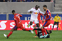Harrison, NJ - Thursday March 01, 2018: Bradley Wright-Phillips, Donis Escober. The New York Red Bulls defeated C.D. Olimpia 2-0 (3-1 on aggregate) during a 2018 CONCACAF Champions League Round of 16 match at Red Bull Arena.