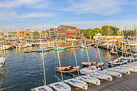 Yachts and sailboats return to their slips in the Annapolis Yacht Club on Spa Creek after Wednesday Night Racing activities in Annapolis, Maryland.