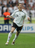 German midfielder (18) Tim Borowski celebrates converting his penalty kick.  Germany defeated Argentina on penalty kicks after leaving the scored tied in regulation, 1-1,  in their FIFA World Cup quarterfinal match at FIFA World Cup Stadium in Berlin, Germany, June 30, 2006.
