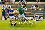 St Senan's V Milltowen/Castlemaine: St. Senan's Sean McGrath gets the balll away deespite the close attention of Milltown/Castlemaine's ..........