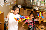 Education Preschool pretend play boy and girl flying airplane constructions made from building toys