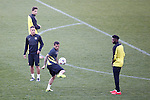 FC Barcelona´s Dani Alves, Alex Song and Adriano  during a training at the Vicente Calderon stadium in Madrid, Spain. Atletico de Madrid will face FC Barcelona in the second leg quarterfinal Champions League soccer match.  April 8, 2014. (ALTERPHOTOS/Victor Blanco)