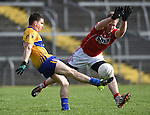 Martin Mc Mahon of Clare in action against Ruairi Deane of Cork during their National Football League game at Cusack Park. Photograph by John Kelly.