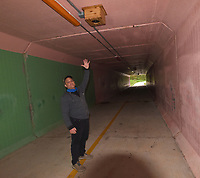 Craig Colorusso shows one of the speakers April 16 2021 that produce the soun mural he composed.<br />(NWA Democrat-Gazette/Flip Putthoff)