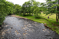 Cumbria, England, UK.  River Irthing and Hikers on the Hadrian's Wall Footpath.