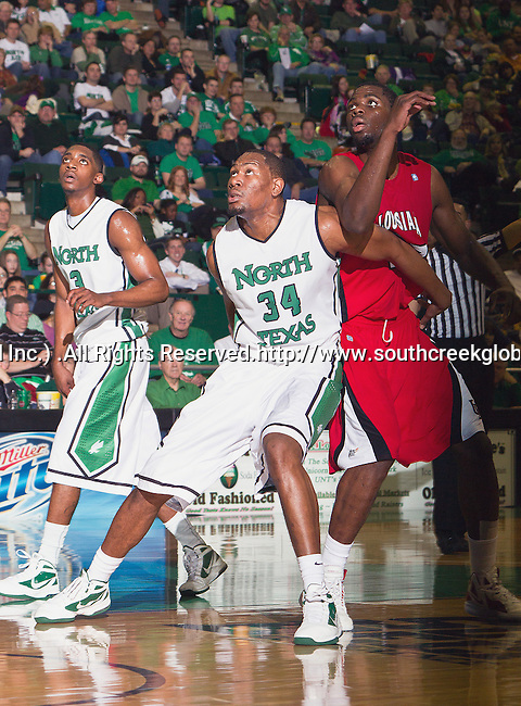 North Texas Mean Green forward Alonzo Edwards (34) in action during the game between the Louisiana Lafayette Ragin Cajuns and the University of North Texas Mean Green at the North Texas Coliseum,the Super Pit, in Denton, Texas. Louisiana Lafayette defeats UNT 57 to 53.