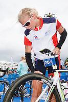17 JUL 2011 - HAMBURG, GER - Emma Jackson (AUS) checks her bike in transition ahead of the start of the women's Hamburg round of triathlon's ITU World Championship Series .(PHOTO (C) NIGEL FARROW)