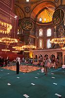 Visitors take photos inside Hagia Sophia mosque, Istanbul, Turkey