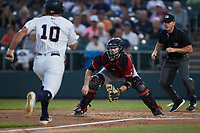 Altoona Curve catcher Jason Delay (38) waits for a throw as Aaron Palensky (10) of the Somerset Patriots hustles towards home plate at TD Bank Ballpark on July 24, 2021, in Somerset NJ. (Brian Westerholt/Four Seam Images)