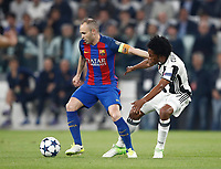 Football Soccer: UEFA Champions UEFA Champions League quarter final first leg Juventus-Barcellona, Juventus stadium, Turin, Italy, April 11, 2017. <br /> Barcellona's Andrés iniesta (l) in action with Juventus Juan Cuadrado (r) during the Uefa Champions League football match between Juventus and Barcelona at the Juventus stadium, on April 11 ,2017.<br /> UPDATE IMAGES PRESS/Isabella Bonotto