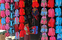 A Palestinian boy looks at school bags in the market in Gaza City, Wednesday, Aug. 29, 2007. (FADY ADWAN)