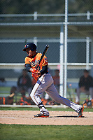 Baltimore Orioles Jomar Reyes (10) follows through on a swing during a minor league Spring Training game against the Boston Red Sox on March 16, 2017 at the Buck O'Neil Baseball Complex in Sarasota, Florida.  (Mike Janes/Four Seam Images)