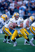 OAKLAND, CA - Quarterback Brett Favre of the Green Bay Packers in action during a game against the Oakland Raiders at the Oakland Coliseum in Oakland, California in 1997. Photo by Brad Mangin