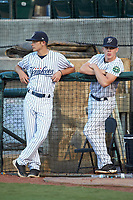 The Pulaski Yankees batboys wait for the start of the game against the Princeton Rays at Calfee Park on July 14, 2018 in Pulaski, Virginia. The Rays defeated the Yankees 13-1.  (Brian Westerholt/Four Seam Images)